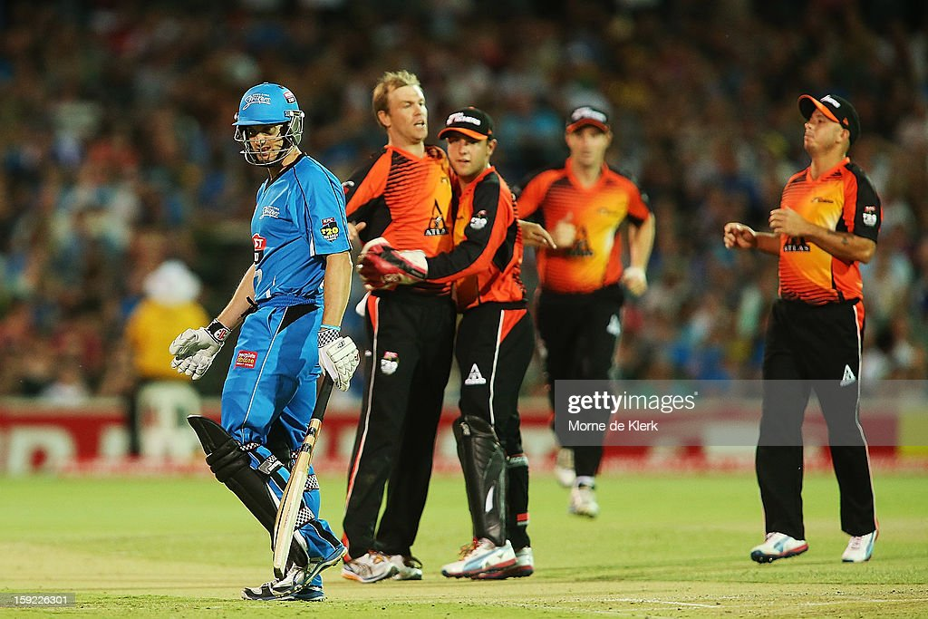 Michael Klinger of Adelaide leaves the field after getting out as Michael Beer of Perth celebrates with team mates during the Big Bash League match between the Adelaide Strikers and the Perth Scorchers at Adelaide Oval on January 10, 2013 in Adelaide, Australia.