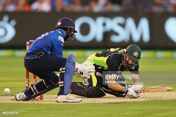 Michael Klinger of Australia slips over when playing a stroke during the first International Twenty20 match between Australia and Sri Lanka at...