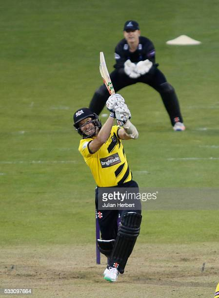 Michael Klinger of Gloucestershire hits out as Ben Brown of Sussex Sharks looks on during the NatWest t20 Blast match between Gloucestershire and...