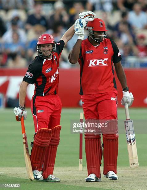 Michael Klinger of the Redbacks taps his team mate Kieron Pollard on the helmet after Pollard hit his first six during the Twenty20 Big Bash match...