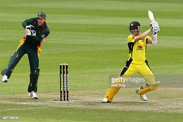 Michael Klinger of the Warriors plays a cut shot during the Matador BBQs One Day Cup match between Tasmania and Western Australia at North Sydney...