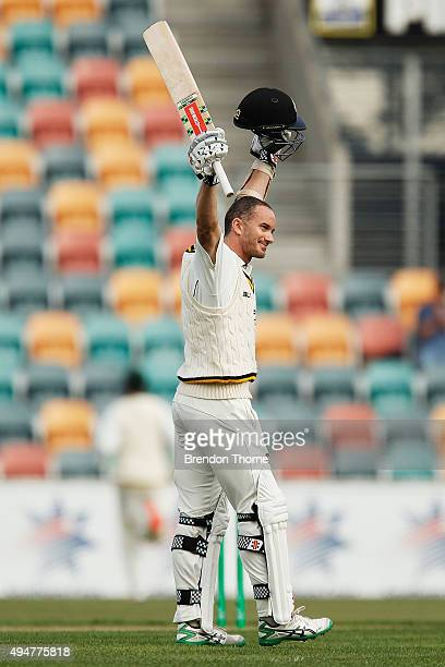 Michael Klinger of Western Australia celebrates scoring his double century during day two of the Sheffield Shield match between Tasmania and Western...
