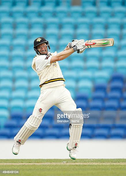 Michael Klinger of Western Australia plays a cut shot during day one of the Sheffield Shield match between Tasmania and Western Australia at...