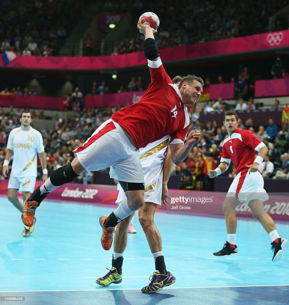 Michael Knudsen of Denmark holds off Eduardo Gurbindo Martinez of Spain to score during the Men's Handball Preliminary match between Denmark and Spain on Day 4 of the London 2012 Olympic Games at The Copper Box on July 31, 2012 in London, England.