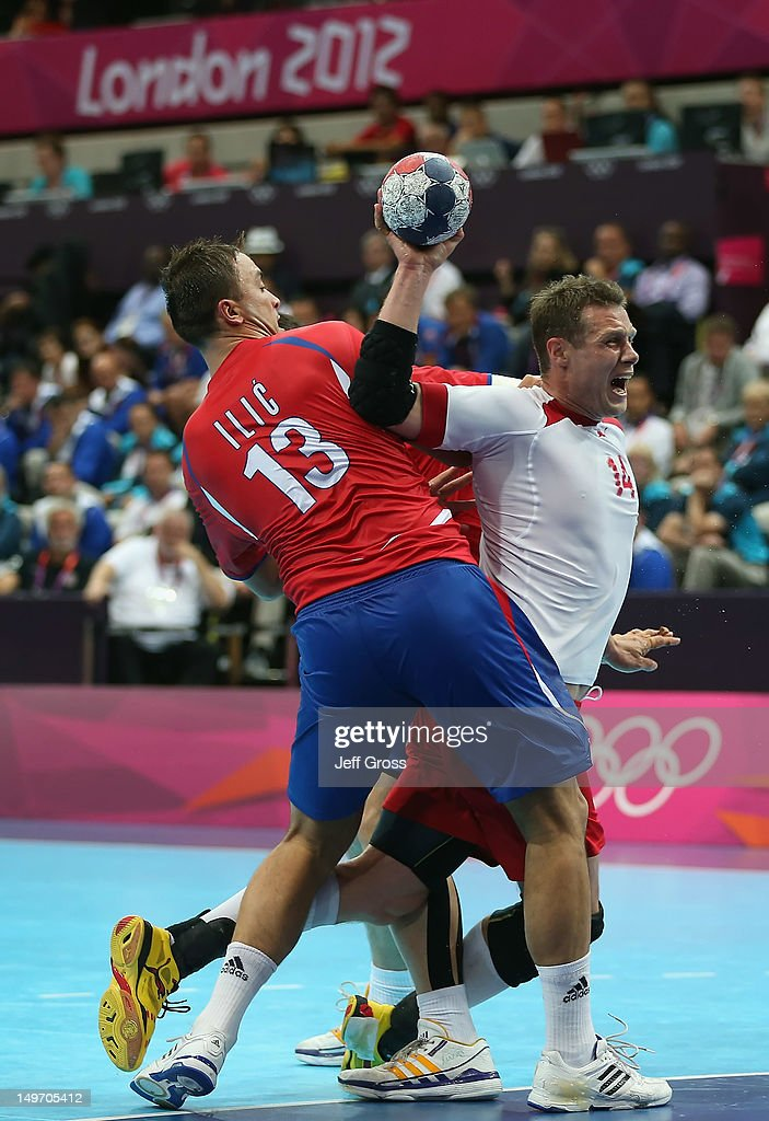 Michael Knudsen #14 of Denmark is fouled by Momir Ilic #13 of Serbia in the Men's Preliminaries Group B match between Serbia and Denmark on Day 6 of the London 2012 Olympic Games at The Copper Box on August 2, 2012 in London, England.