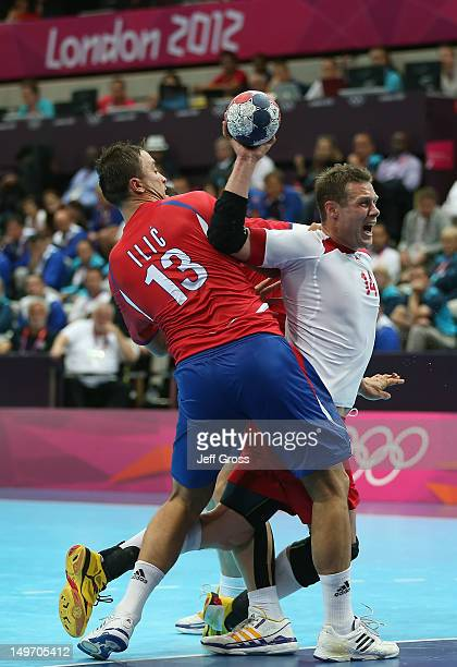 Michael Knudsen of Denmark is fouled by Momir Ilic of Serbia in the Men's Preliminaries Group B match between Serbia and Denmark on Day 6 of the...