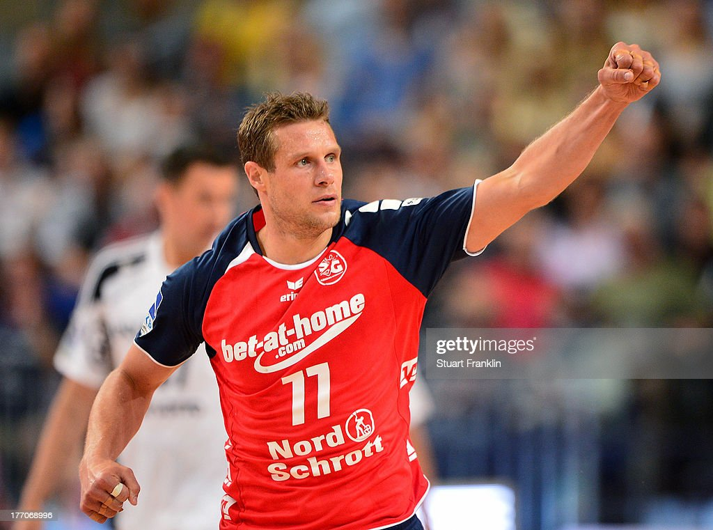 Michael Knudsen of Flensburg celebrates during th DKB supercup match between THW Kiel and Flensburg Handewitt at OVB arena on August 20, 2013 in Bremen, Germany.