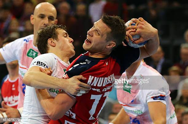 Michael Knudsen of Flensburg challenges Henrik Toft Hansen of Hamburg for the ball during the VELUX EHF Handball Champions League group D match...