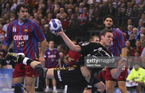 Michael Knudsen of Flensburg throws at goal during the Champions League quarter final game between SG Flensburg Handewitt and FC Barcelona at the...