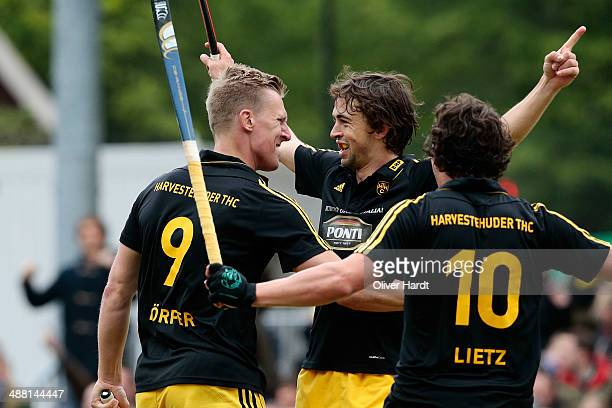 Michael Koerper and Tobias Hauke of Hamburg celebrate after scoring during the Bundesliga match between Harvestehuder THC v Rot Weiss Koeln 69th...