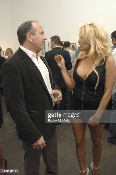 Michael Kohn and Pamela Anderson attend SHE Images of women by Wallace Berman and Richard Prince Opening at Michael Kohn Gallery on January 15 2009...