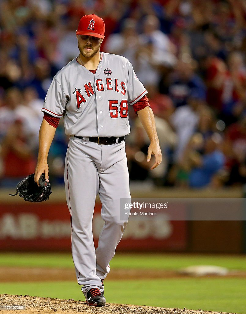 Michael Kohn #58 of the Los Angeles Angels walks off the mound after giving up the game winning homerun against the Texas Rangers at Rangers Ballpark in Arlington on July 31, 2013 in Arlington, Texas.