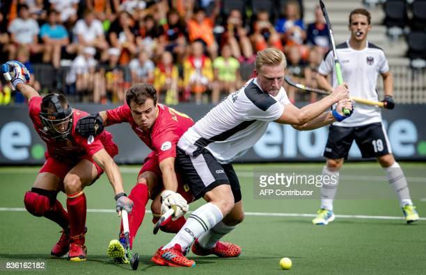 TOPSHOT Michael Korper of Austria scores a goal past Austrian defenders during the Men's EuroHockey Championships 2017 match between Spain and...