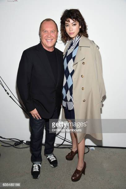 Michael Kors and actress Hikari Mori attend the Michael Kors Collection Fall 2017 runway show at Spring Studios on February 15 2017 in New York City