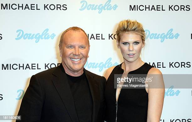 Michael Kors and Alexandra Richards attend the opening by designer Michael Kors of Fragrance Beauty Corner at Douglas on September 19 2013 in Munich...