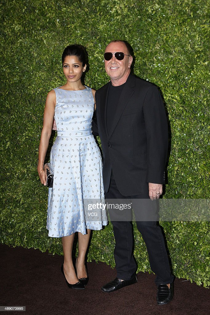 <a gi-track='captionPersonalityLinkClicked' href=/galleries/search?phrase=Michael+Kors+-+Fashion+Designer&family=editorial&specificpeople=4289231 ng-click='$event.stopPropagation()'>Michael Kors</a> (R) and <a gi-track='captionPersonalityLinkClicked' href=/galleries/search?phrase=Freida+Pinto&family=editorial&specificpeople=5518973 ng-click='$event.stopPropagation()'>Freida Pinto</a> attend the <a gi-track='captionPersonalityLinkClicked' href=/galleries/search?phrase=Michael+Kors+-+Fashion+Designer&family=editorial&specificpeople=4289231 ng-click='$event.stopPropagation()'>Michael Kors</a> Jet Set Experience on May 9, 2014 in Shanghai, China.