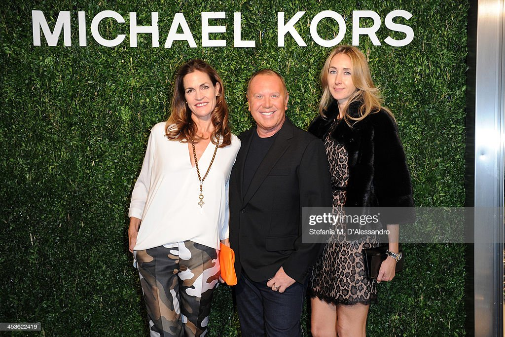 Michael Kors and guest attend Michael Kors To celebrate Milano opening on December 4, 2013 in Milan, Italy.