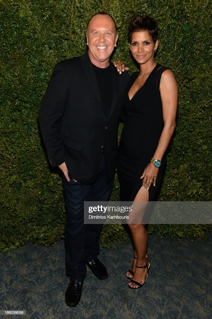 Michael Kors and Halle Berry attend a dinner in honor of Halle Berry as she joins Michael Kors and the United Nations World Food Programme to help fight world hunger. The event was held at The Pool Room at the Four Seasons on April 6, 2013 in New York City.