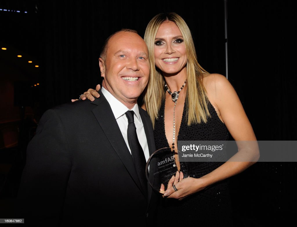 Michael Kors (L) and Heidi Klum attend the amfAR New York Gala to kick off Fall 2013 Fashion Week at Cipriani Wall Street on February 6, 2013 in New York City.