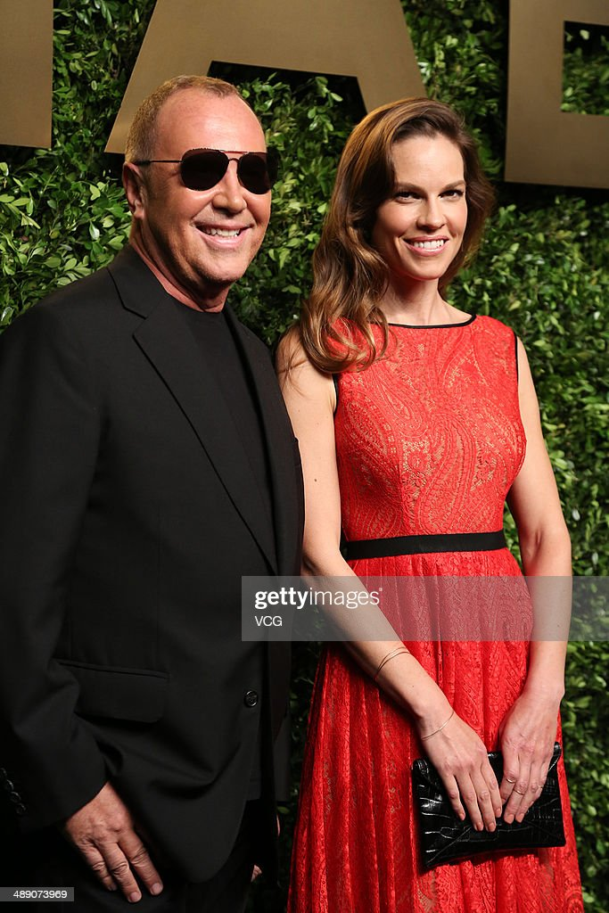 <a gi-track='captionPersonalityLinkClicked' href=/galleries/search?phrase=Michael+Kors+-+Fashion+Designer&family=editorial&specificpeople=4289231 ng-click='$event.stopPropagation()'>Michael Kors</a> (L) and <a gi-track='captionPersonalityLinkClicked' href=/galleries/search?phrase=Hilary+Swank&family=editorial&specificpeople=201692 ng-click='$event.stopPropagation()'>Hilary Swank</a> attend the <a gi-track='captionPersonalityLinkClicked' href=/galleries/search?phrase=Michael+Kors+-+Fashion+Designer&family=editorial&specificpeople=4289231 ng-click='$event.stopPropagation()'>Michael Kors</a> Jet Set Experience on May 9, 2014 in Shanghai, China.