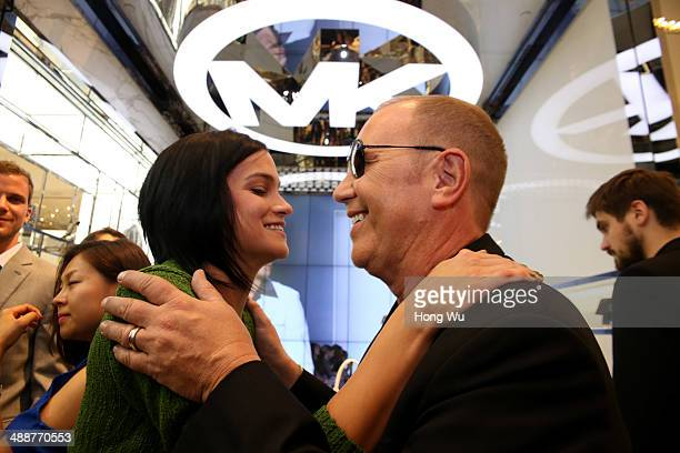 Michael Kors and Leigh lezark attend the Michael Kors Kerry Centre Flagship Store opening ceremony on May 8 2014 in Shanghai China