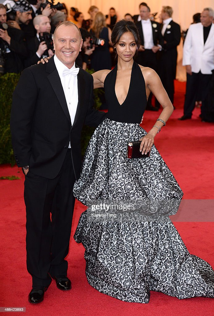 Michael Kors and Zoe Saldana attend the 'Charles James: Beyond Fashion' Costume Institute Gala held at the Metropolitan Museum of Art on May 5, 2014 in New York City.