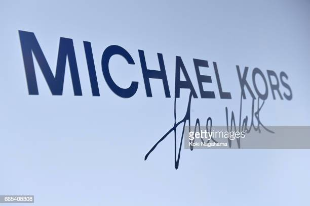 Michael Kors logo is seen on the entrance wall at the live performance by Lion Babe at the Billboard Tokyo during 'Michael Kors The Walk Celebration...
