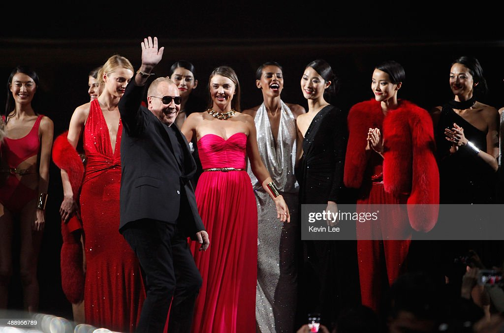 Michael Kors waves to guest after the fashion show for a picture after The Michael Kors Jet Set Experience fashion show on May 9, 2014 in Shanghai, China.