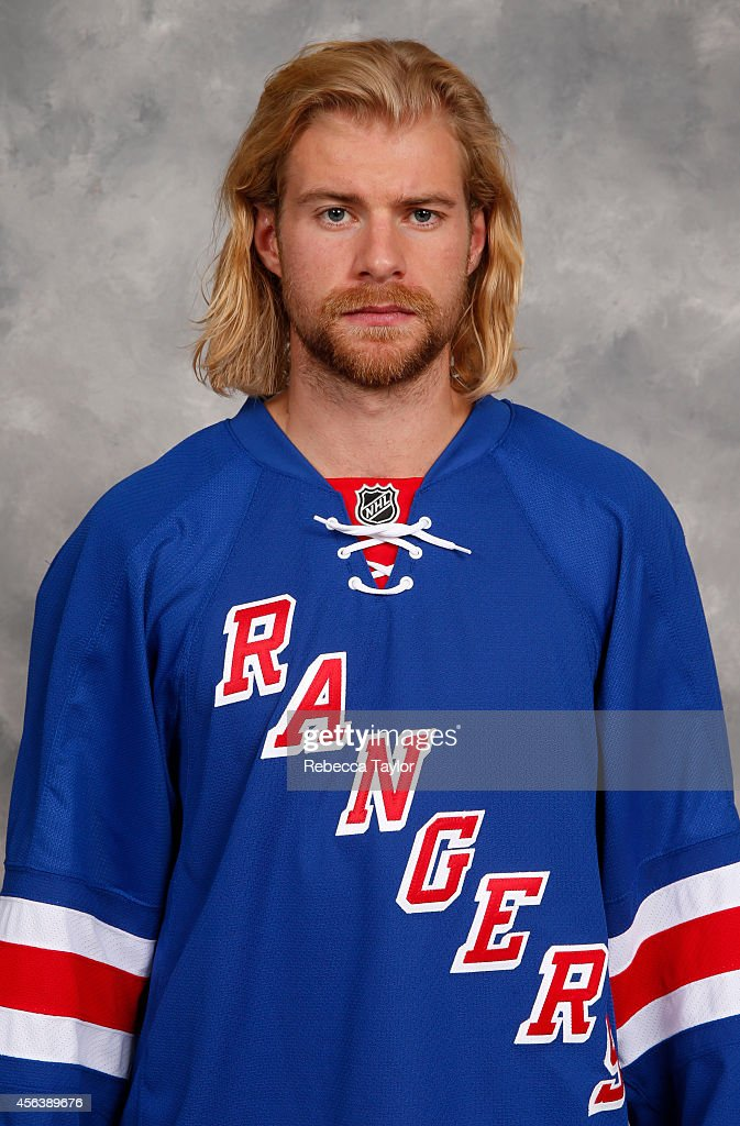 Michael Kostka of the New York Rangers poses for his official headshot for the 2014-2015 season on September 18, 2014 in White Plains, New York.