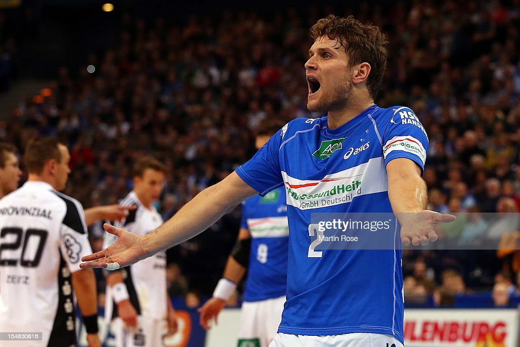 <a gi-track='captionPersonalityLinkClicked' href=/galleries/search?phrase=Michael+Kraus&family=editorial&specificpeople=579019 ng-click='$event.stopPropagation()'>Michael Kraus</a> of Hamburg reacts during the DKB Handball Bundesliga match between HSV Hamburg and THW Kiel at the O2 World on October 27, 2012 in Hamburg, Germany.