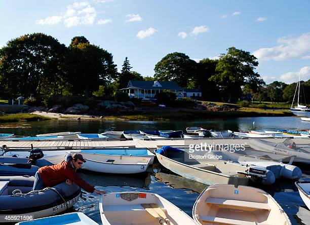 Michael Krauser of Ipswich negotiates his way out of his slip at Tuck's Point in Manchesterbythesea Massachusetts September 17 2014