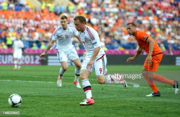 Michael KrohnDehli of Denmark breaks through to score their first goal during the UEFA EURO 2012 group B match between Netherlands and Denmark at...