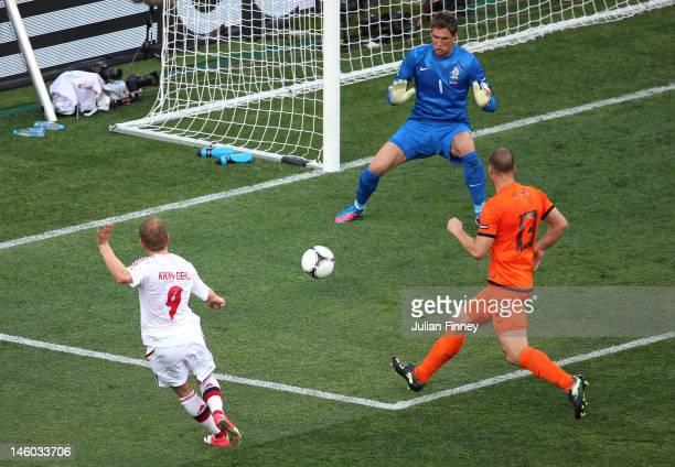 Michael KrohnDehli of Denmark scores their first goal past Maarten Stekelenburg of Netherlands during the UEFA EURO 2012 group B match between...