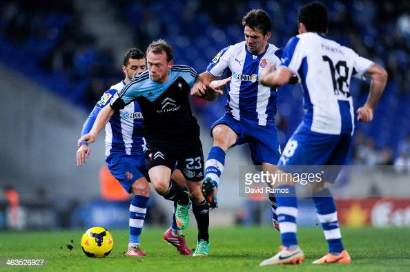 Michael KrohnDehli of RC Celta de Vigo duels for the ball with Simao Sabrosa and Victor Sanchez of RCD Espanyol during the La Liga match between RCD...