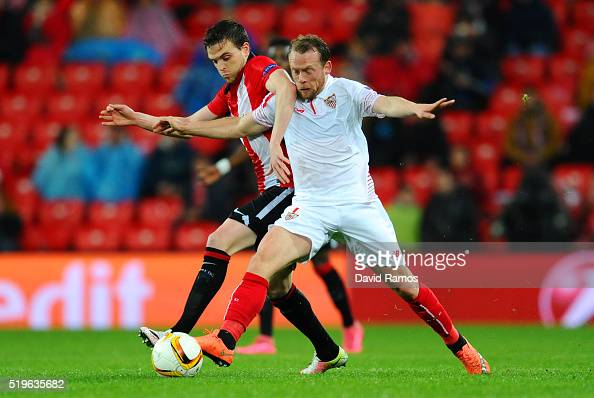 Michael KrohnDehli of Sevilla and Javier Eraso of Athletic Club Bilbao battle for the ball during the UEFA Europa League quarter final first leg...