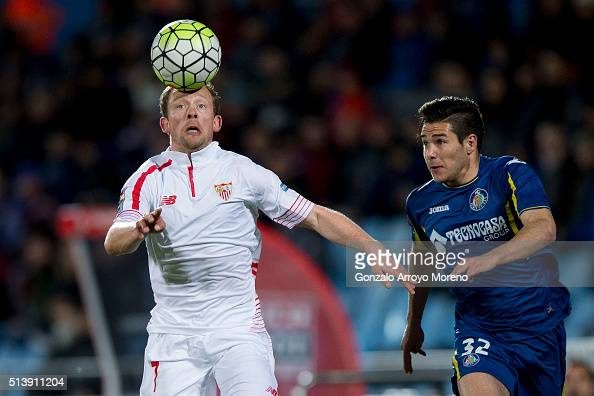 Michael KrohnDehli of Sevilla FC competes for the ball with Emiliano Buendia of Getafe CF during the La Liga match between Getafe CF and Sevilla CF...