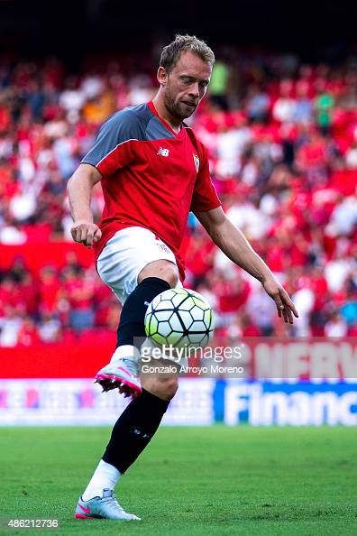 Michael KrohnDehli of Sevilla FC controls the ball during his warming up before the La Liga match between Sevilla FC and Club Atletico de Madrid at...