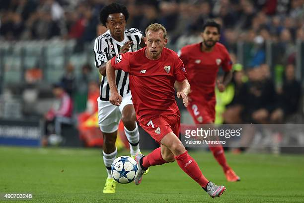 Michael KrohnDehli of Sevilla in action against Juan Cuadrado of Juventus during the UEFA Champions League group E match between Juventus and Sevilla...