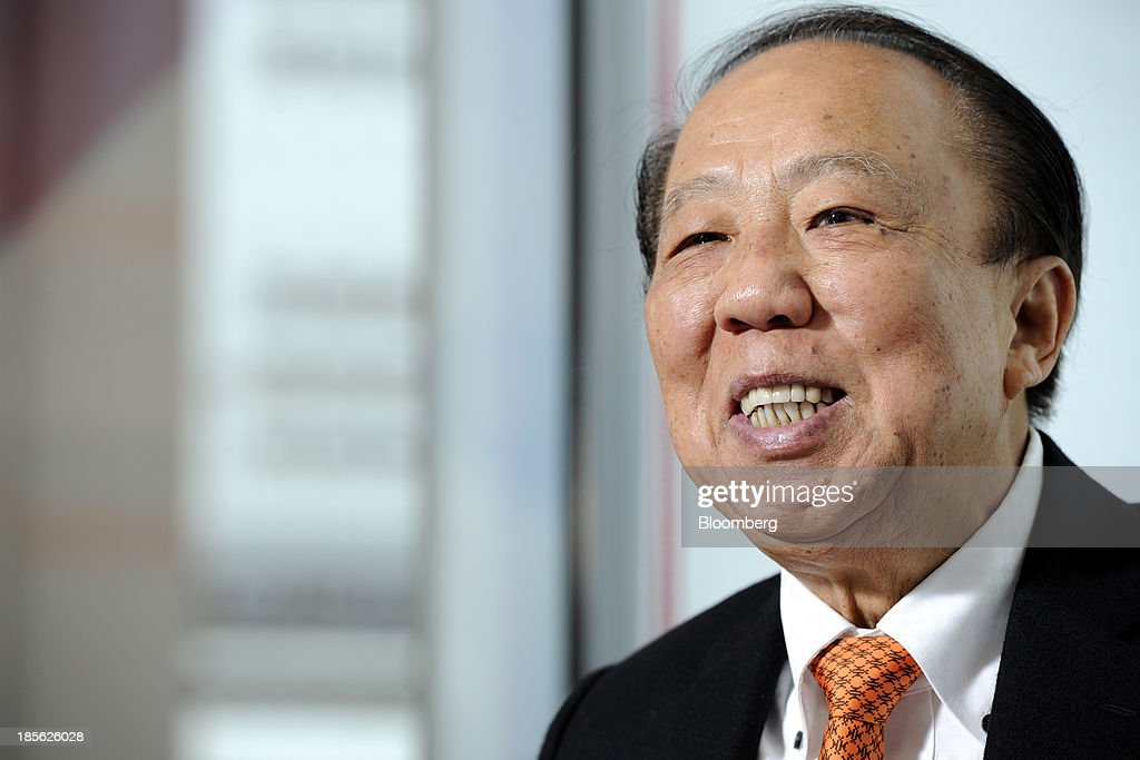 Michael Kum, chairman of M&L Hospitality Trust, reacts during an interview in Singapore, on Tuesday, Oct. 22, 2013. M&L, the owner of Australia's biggest hotel, may seek a listing in the country after abandoning its initial stock sale in Singapore last year. Photographer: Munshi Ahmed/Bloomberg via Getty Images