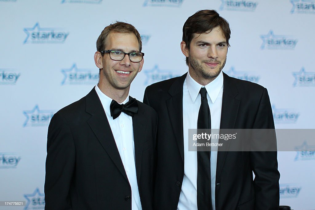 Michael Kutcher and brother <a gi-track='captionPersonalityLinkClicked' href=/galleries/search?phrase=Ashton+Kutcher&family=editorial&specificpeople=202015 ng-click='$event.stopPropagation()'>Ashton Kutcher</a> walk the red carpet before the 2013 Starkey Hearing Foundation's 'So the World May Hear' Awards Gala on July 28, 2013 in St. Paul, Minnesota.