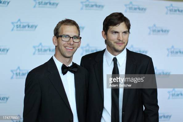 Michael Kutcher and brother Ashton Kutcher walk the red carpet before the 2013 Starkey Hearing Foundation's 'So the World May Hear' Awards Gala on...
