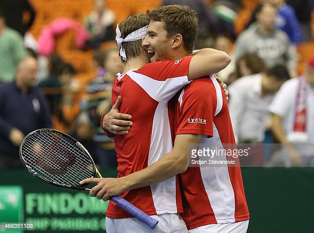 Michael Lammer and Marco Chiudinelli of Switzerland celebrate victory against Serbia after men's doubles match on day two of the Davis Cup match...