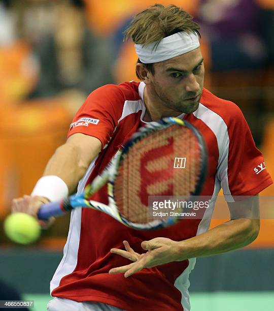 Michael Lammer of Switzerland plays a backhand against Dusan Lajovic of Serbia during the day three of the Davis Cup match between Serbia and...