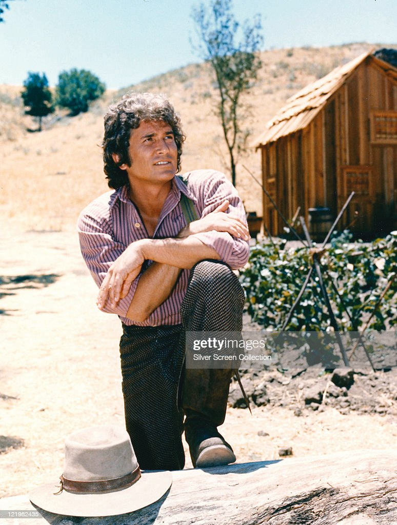 <a gi-track='captionPersonalityLinkClicked' href=/galleries/search?phrase=Michael+Landon&family=editorial&specificpeople=228407 ng-click='$event.stopPropagation()'>Michael Landon</a> (1936-1991), US actor, poses with his arms crossed and resting on his knee with a log cabin the background in a portrait issued as publicity for the US television series, 'Little House on the Prairie', circa 1974. The drama, adapted from the novels by Laura Ingalls Wilder (1867-1957), starred Landon as 'Charles Ingalls'.
