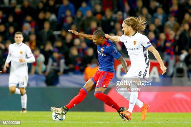 Michael Lang of Basel in action against Vitinho of CSKA Moscow during the UEFA Champions League Group A soccer match between CSKA Moscow and Basel at...