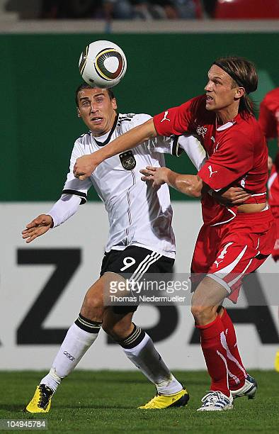 Michael Lang of the Switzerland fights for the ball with Cenk Tosun of Germany during the men's U20 International friendly match between Germany and...