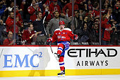 Michael Latta of the Washington Capitals celebrates after scoring a first period goal against the Ottawa Senators at Verizon Center on December 16...