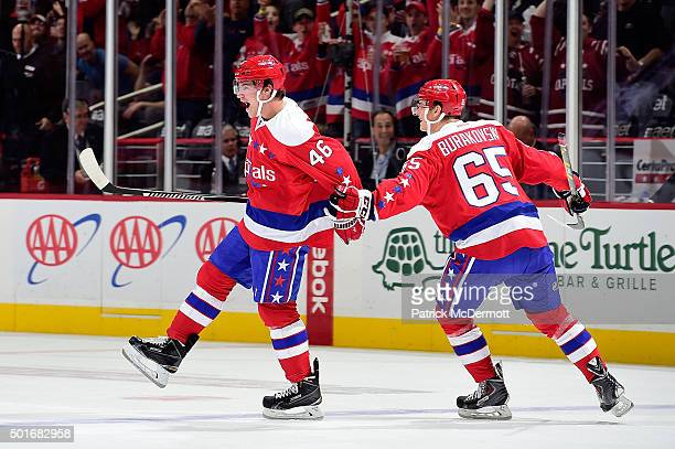 Michael Latta of the Washington Capitals celebrates with his teammate Andre Burakovsky after scoring a goal against the Ottawa Senators in the first...