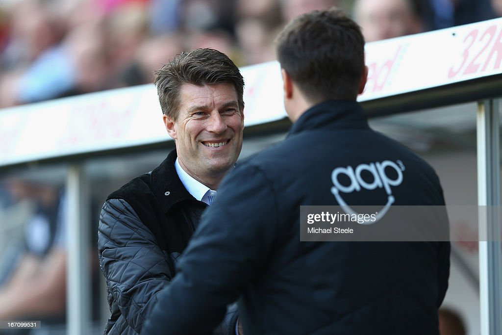 <a gi-track='captionPersonalityLinkClicked' href=/galleries/search?phrase=Michael+Laudrup&family=editorial&specificpeople=2380115 ng-click='$event.stopPropagation()'>Michael Laudrup</a> (L) manager of Swansea City greets <a gi-track='captionPersonalityLinkClicked' href=/galleries/search?phrase=Mauricio+Pochettino&family=editorial&specificpeople=234444 ng-click='$event.stopPropagation()'>Mauricio Pochettino</a> (R) the manager of Southampton during the Barclays Premier League match between Swansea City and Southampton at the Liberty Stadium on April 20, 2013 in Swansea, Wales.