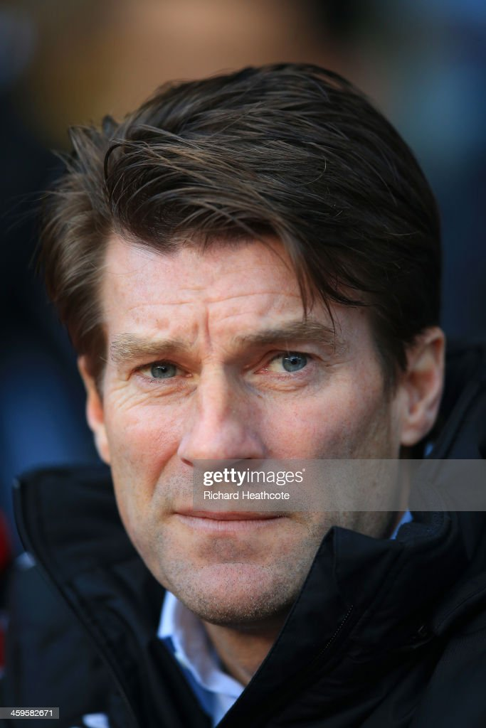 <a gi-track='captionPersonalityLinkClicked' href=/galleries/search?phrase=Michael+Laudrup&family=editorial&specificpeople=2380115 ng-click='$event.stopPropagation()'>Michael Laudrup</a> manager of Swansea City looks on during the Barclays Premier League match between Aston Villa and Swansea City at Villa Park on December 28, 2013 in Birmingham, England.